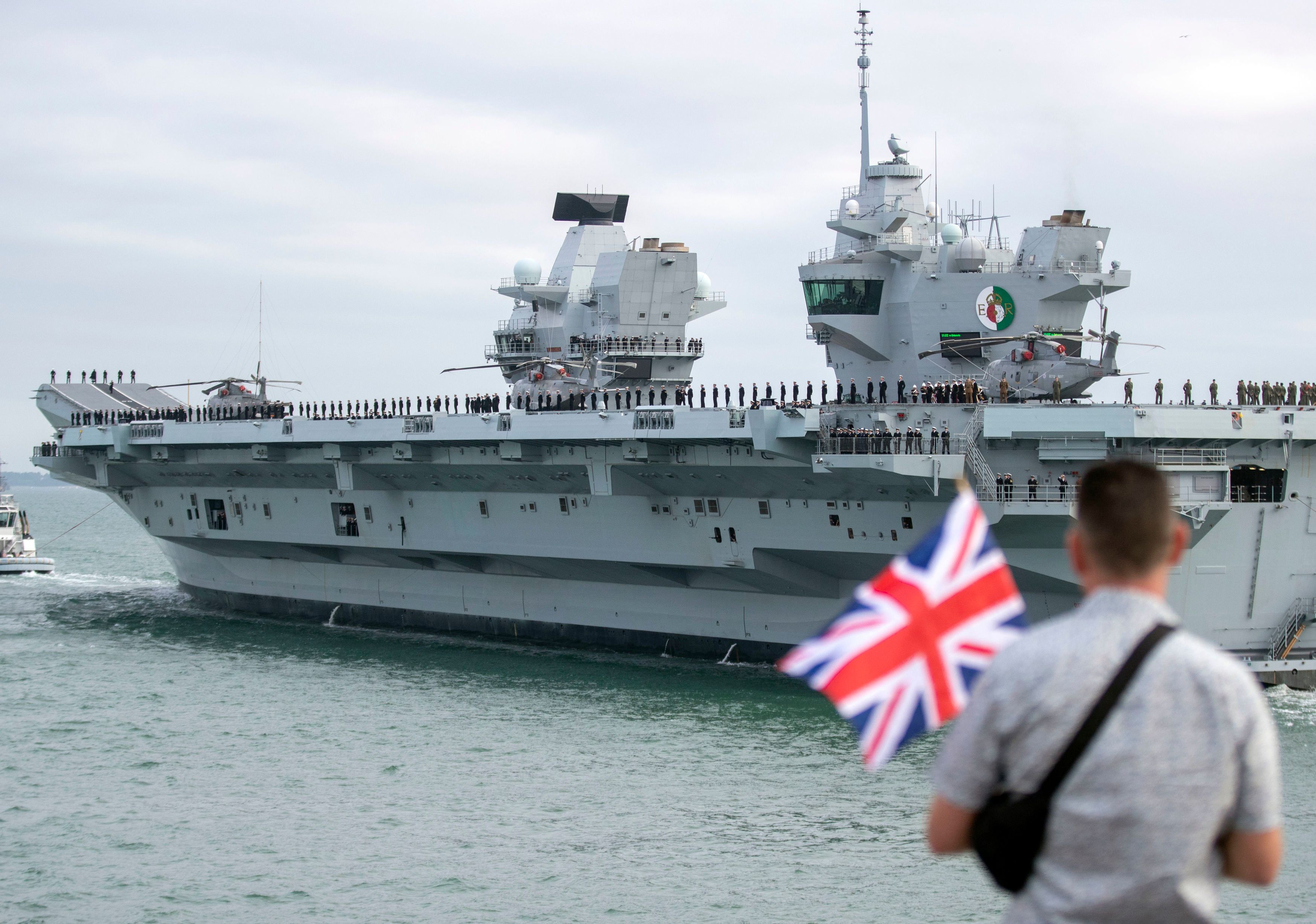 HMS Queen Elizabeth pictured leaving Portsmouth Harbour in