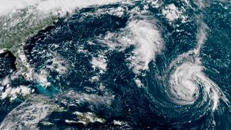 This enhanced satellite image made available by NOAA shows Tropical Storm Florence center in the Atlantic Ocean on Saturday Sept 8 2018 at 2:45 pm EDT