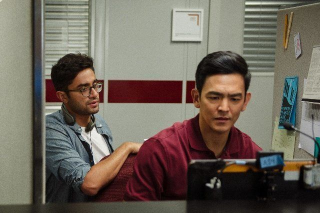 "Director Aneesh Chaganty (left), with actor John Cho (right), on the set of ""Searching."""