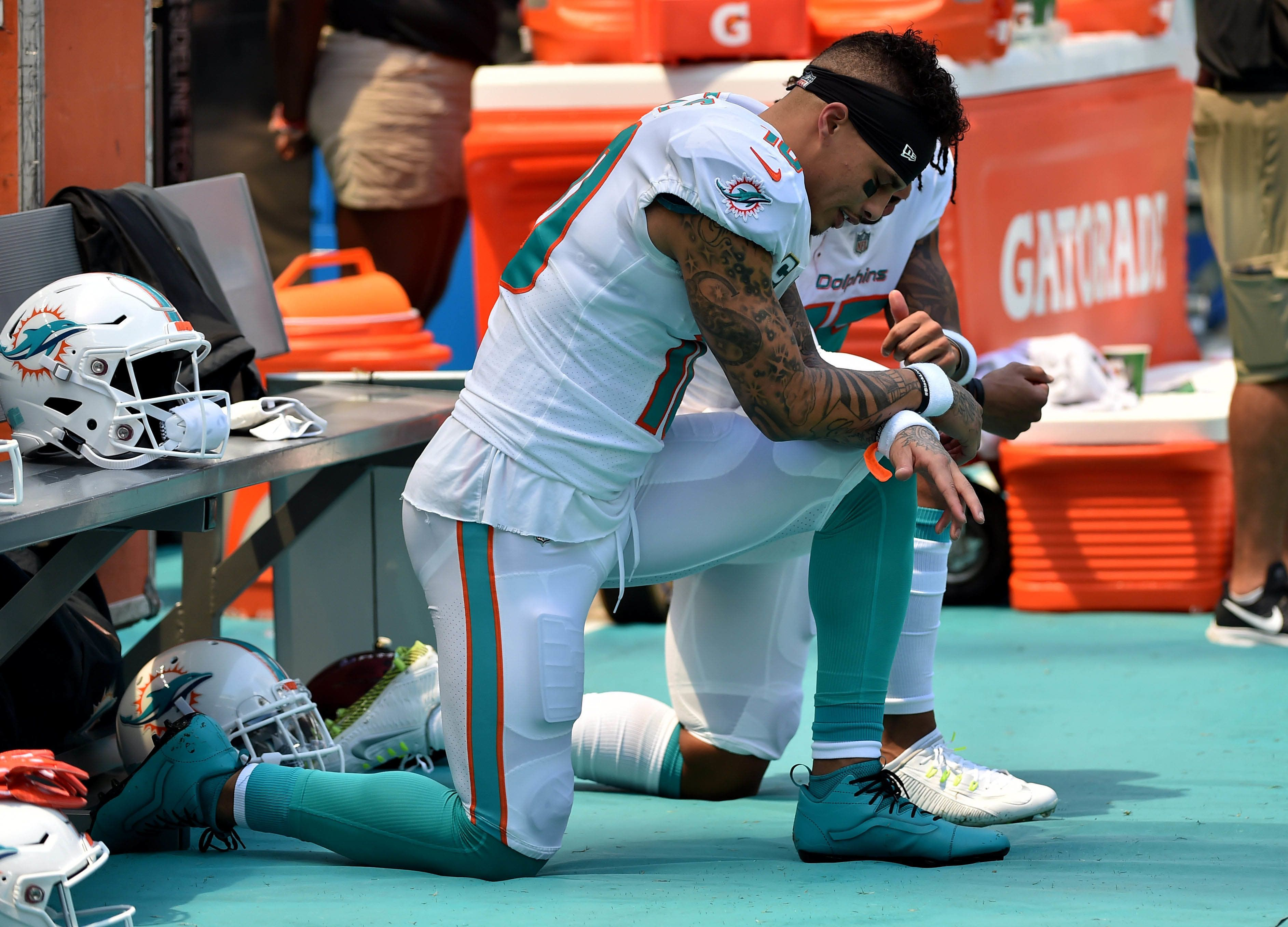 Sep 9, 2018; Miami Gardens, FL, USA; Miami Dolphins wide receiver Kenny Stills (left) and Dolphins wide receiver Albert Wilson (right) both kneel during the national anthem prior to a game against the Tennessee Titans at Hard Rock Stadium. Mandatory Credit: Steve Mitchell-USA TODAY Sports