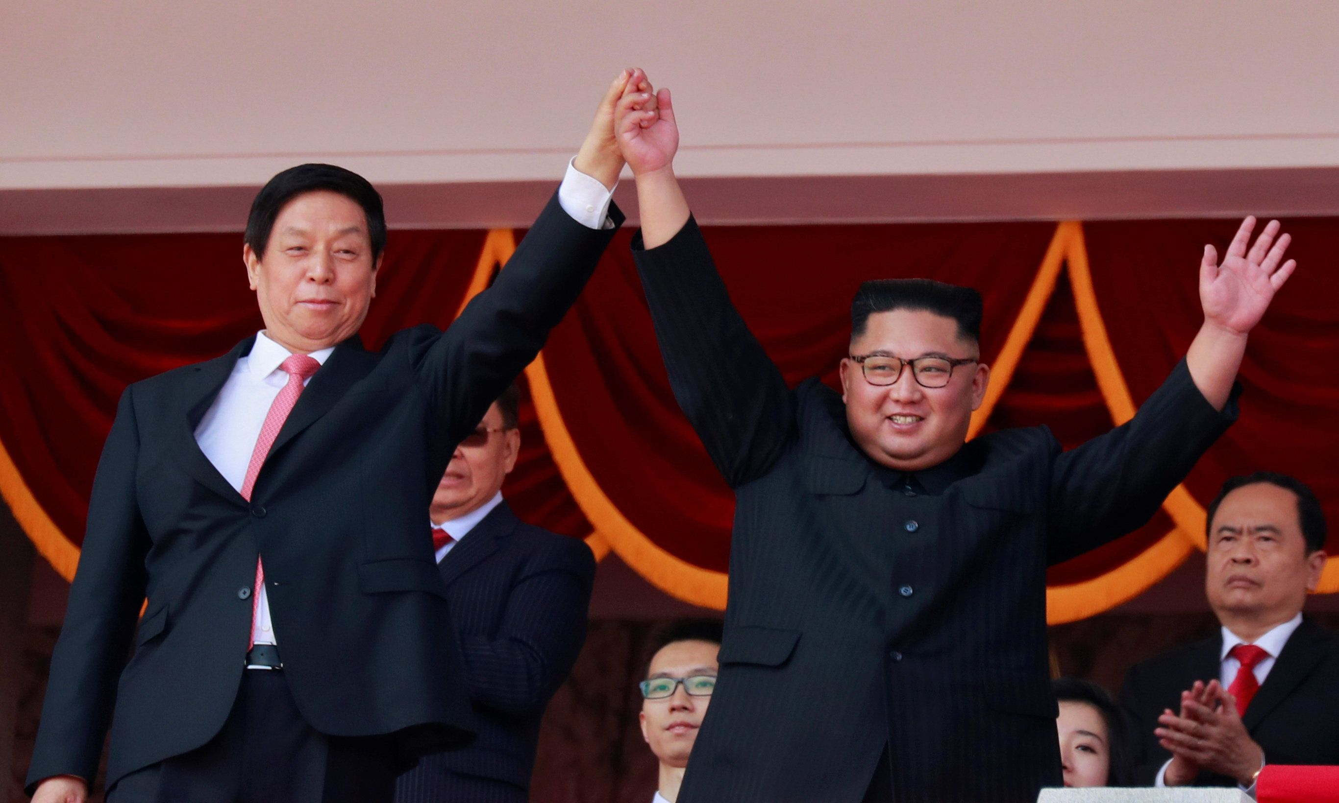 North Korean leader Kim Jong Un and China's Li Zhanshu, chairman of the Standing Committee of the National People's Congress (NPC), wave to people while attending a military parade marking the 70th anniversary of North Korea's foundation in Pyongyang, North Korea, September 9, 2018. REUTERS/Danish Siddiqui