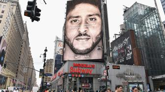 TOPSHOT - A Nike Ad featuring American football quarterback  Colin Kaepernick is on diplay September 8, 2018 in New York City. - Nike's new ad campaign featuring Kaepernick, the American football player turned activist against police violence, takes a strong stance on a divisive issue which could score points with millennials but risks alienating conservative customers. The ads prompted immediate calls for Nike boycotts over Kaepernick, who has been castigated by US President Donald Trump and other conservatives over his kneeling protests during the playing of the US national anthem. (Photo by Angela Weiss / AFP)        (Photo credit should read ANGELA WEISS/AFP/Getty Images)