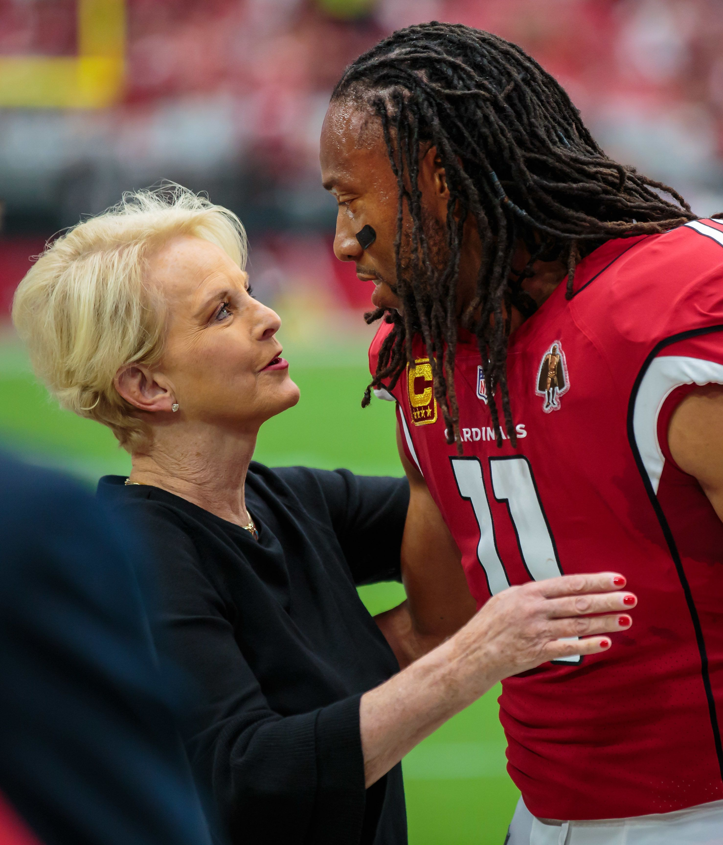 Sep 9, 2018; Glendale, AZ, USA; Arizona Cardinals wide receiver Larry Fitzgerald (11) greets Cindy McCain, widow of former Arizona republican senator John McCain prior to the game against the Washington Redskins at University of Phoenix Stadium. Mandatory Credit: Mark J. Rebilas-USA TODAY Sports