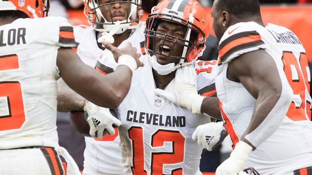 Sep 9, 2018; Cleveland, OH, USA; Cleveland Browns wide receiver Josh Gordon (12) celebrates with quarterback Tyrod Taylor (5) and defensive tackle Devaroe Lawrence (99) after catching a touchdown during the fourth quarter at FirstEnergy Stadium. Mandatory Credit: Ken Blaze-USA TODAY Sports