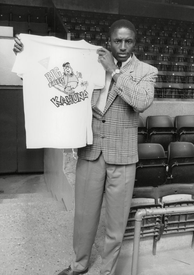Footballer John Fashanu holding a t-shirt identical to the one Lee was wearing when he