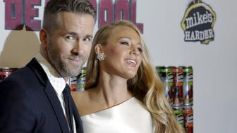 "Actor Ryan Reynolds poses with his wife actress Blake Lively at the premiere of ""Deadpool"" in New York, February 8, 2016. REUTERS/Brendan McDermid"