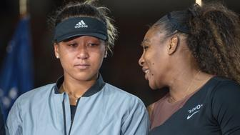 2018 US Open Tennis Tournament- Day Thirteen.  Naomi Osaka of Japan with Serena Williams of the United States at the presentations after the Women's Singles Final on Arthur Ashe Stadium at the 2018 US Open Tennis Tournament at the USTA Billie Jean King National Tennis Center on September 8th, 2018 in Flushing, Queens, New York City.  (Photo by Tim Clayton/Corbis via Getty Images)
