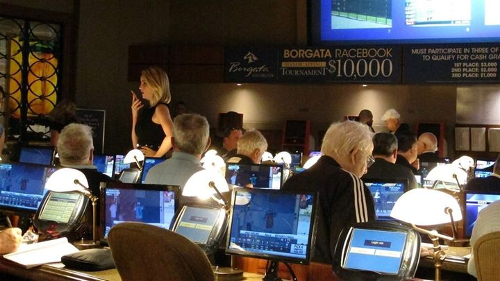 Bettors wait to make wagers on sporting events at the Borgata casino in New Jersey, hours after it began accepting sports bet