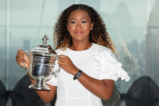 Naomi Osaka of Japan poses with the championship