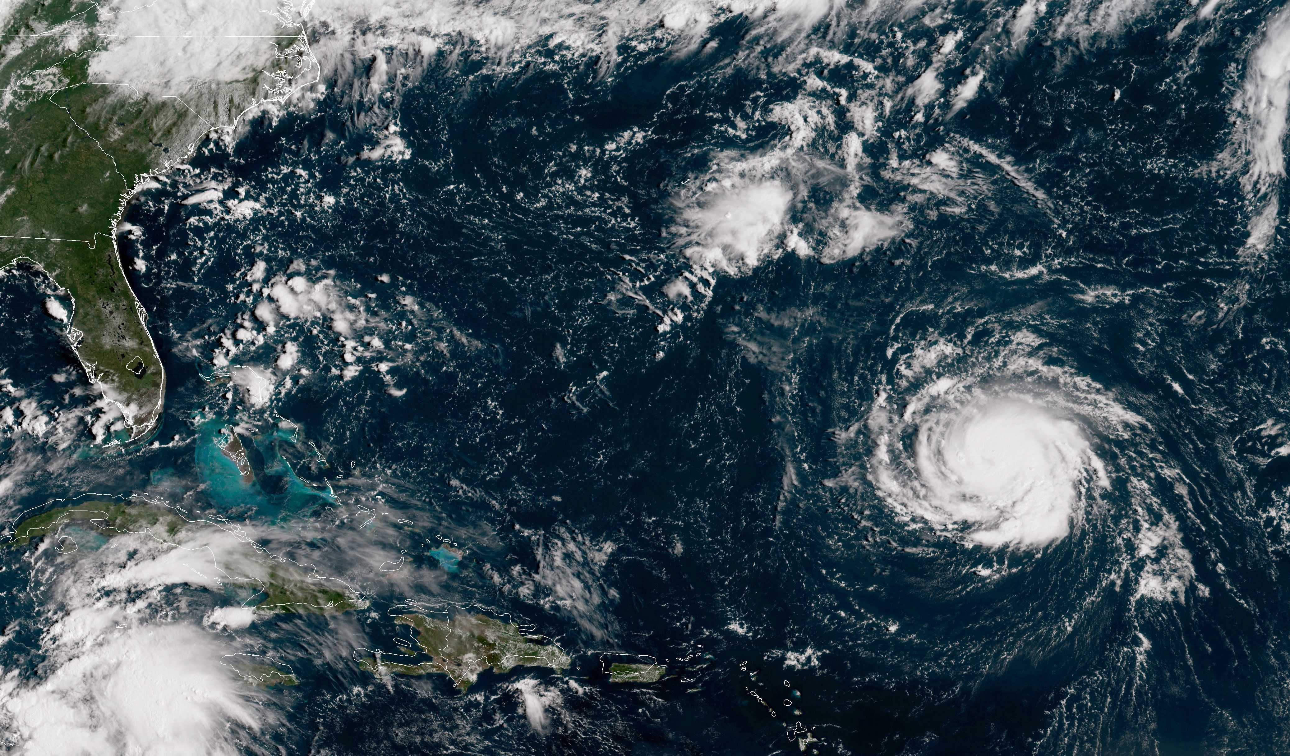ATLANTIC OCEAN - SEPTEMBER 10:  In this NOAA satellite handout image, shows Hurricane Florence as it travels west and gains strength in the Atlantic Ocean southeast of Bermuda on September 10, 2018. Weather predictions say the storm will likely hit the U.S. East Coast as early as Thursday, September 13 bringing massive winds and rain.  (Photo by NOAA via Getty Images)
