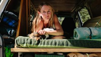 Laura Quinn, 31, in her van home in the Coconino National Forest outside of Flagstaff, Ariz. on July 18, 2018.