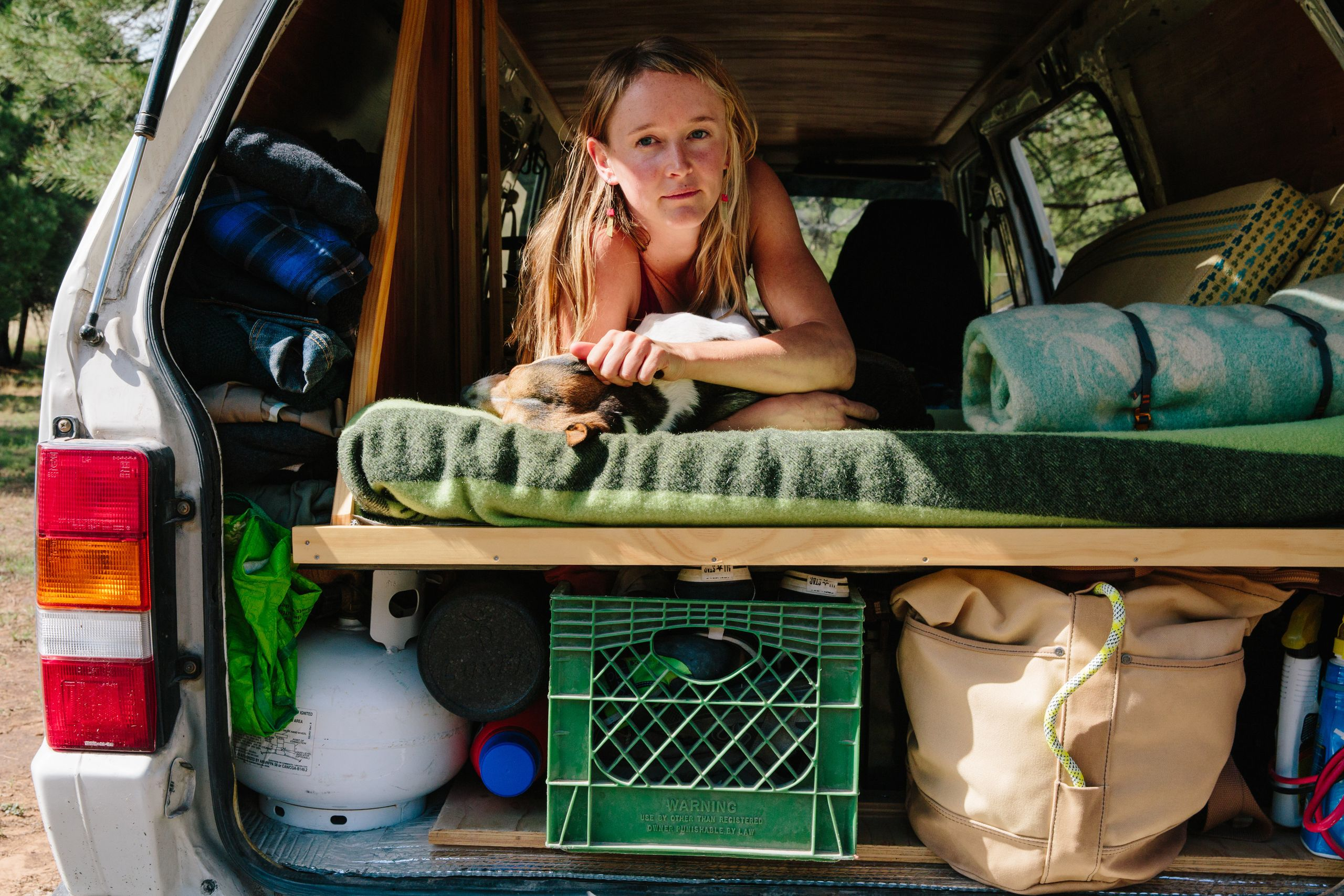Laura Quinn in her van home in the Coconino National Forest outside Flagstaff, Arizona.