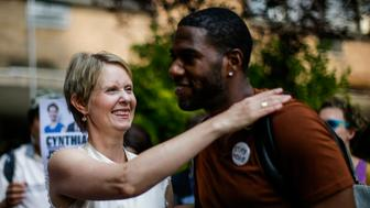 NEW YORK, NY - AUGUST 16: Democratic gubernatorial candidate Cynthia Nixon salutes Council Member Jumaane Williams as they attend a rally for universal rent control on August 16, 2018 in New York City. Cynthia Nixon, who is running against Gov. Andrew M. Cuomo for the governor seat has pushed for a more response to high rents, also, Nixon has said that cities throughout the state should be allowed to impose it. Only NYC and some nearby areas are allowed to impose rent control, and only on apartments built before 1974. (Photo by Eduardo Munoz Alvarez/Getty Images)