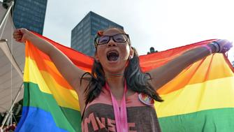 A supporter attends the annual 'Pink Dot' event in a public show of support for the LGBT community at Hong Lim Park in Singapore on July 1, 2017.  Thousands of Singaporeans took part in the gay-rights rally on July 1. / AFP PHOTO / Roslan RAHMAN        (Photo credit should read ROSLAN RAHMAN/AFP/Getty Images)