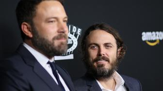 BEVERLY HILLS, CA - NOVEMBER 14: Ben Affleck and Casey Affleck attend the premiere of Amazon Studios' 'Manchester By The Sea' on November 14, 2016 in Beverly Hills, California. (Photo by JB Lacroix/WireImage)