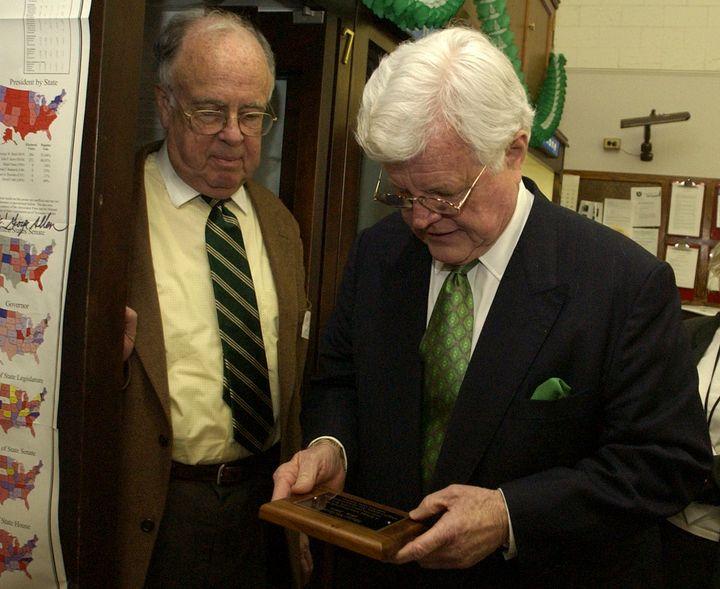 Former New York Times political reporter Adam Clymer, left, and Sen. Ted Kennedy (D-Mass.), inspect a plaque that was dedicat