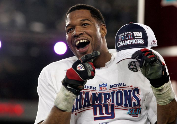 New York Giants defensive end Michael Strahan celebrates after his team's win over the Patriots in the Super Bowl XLII game o