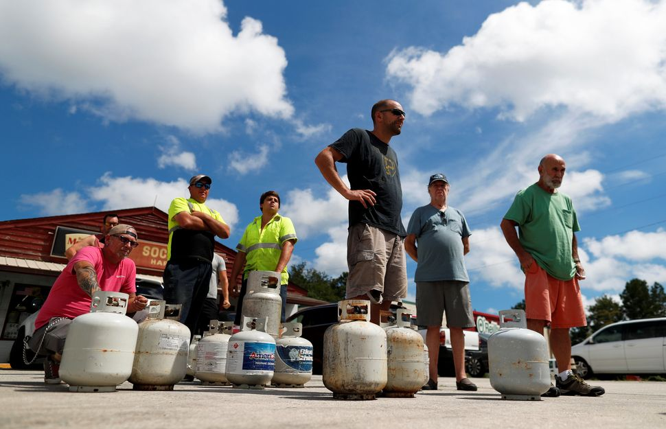Customers line up to buy propane at Socastee Hardware store in Myrtle Beach on Monday.