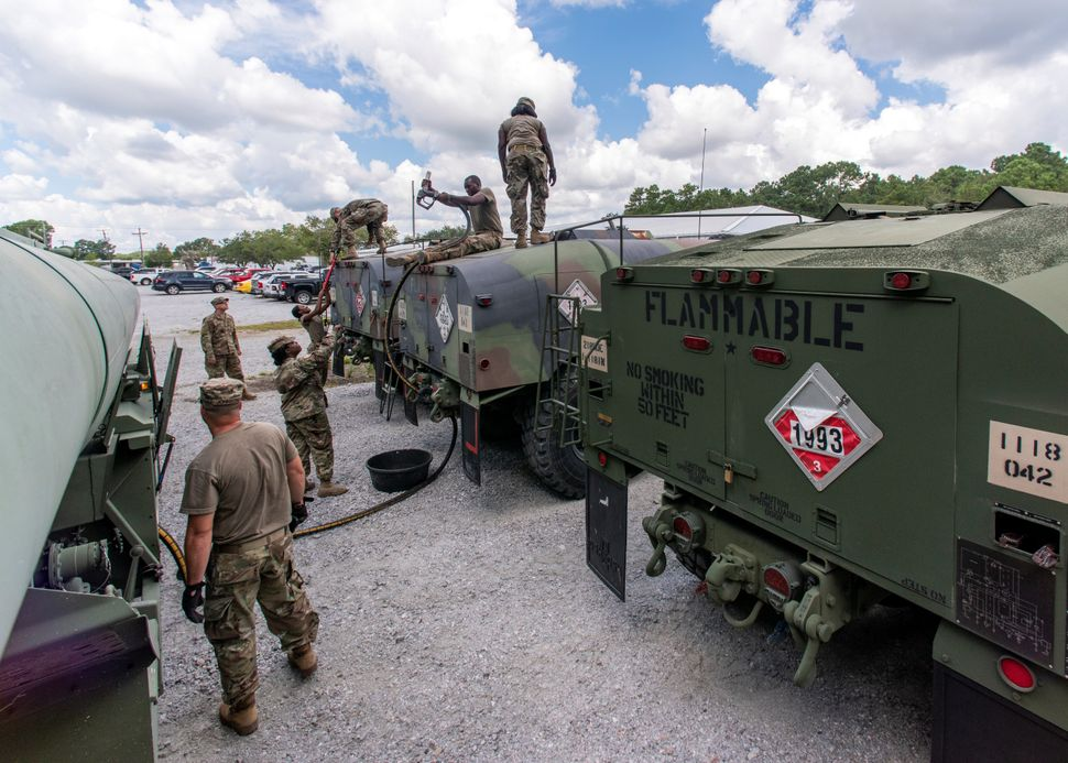 South Carolina National Guard soldiers transfer bulk diesel fuel into fuel tanker trucks for distribution in advance of Hurri
