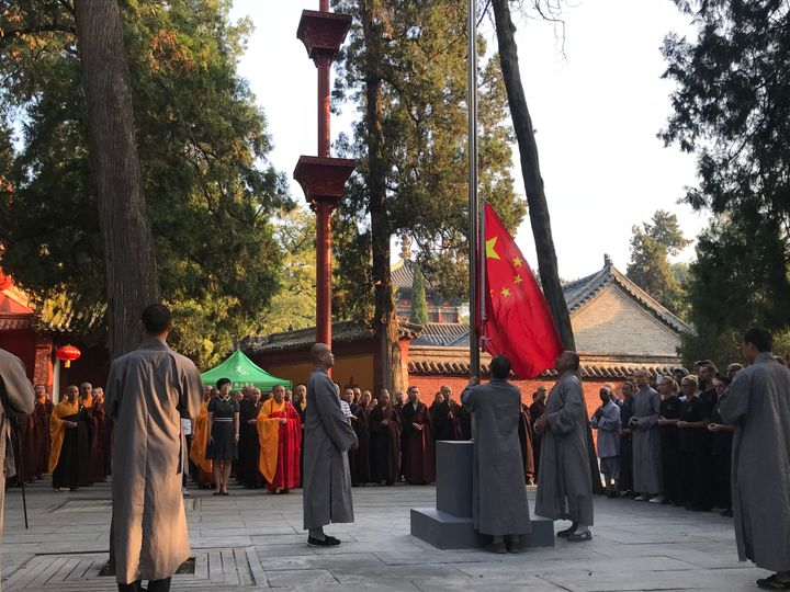 Monks raise the Chinese national flag during a ceremony at Shaolin Temple on August 27, 2018 in Zhengzhou, China. It is the t
