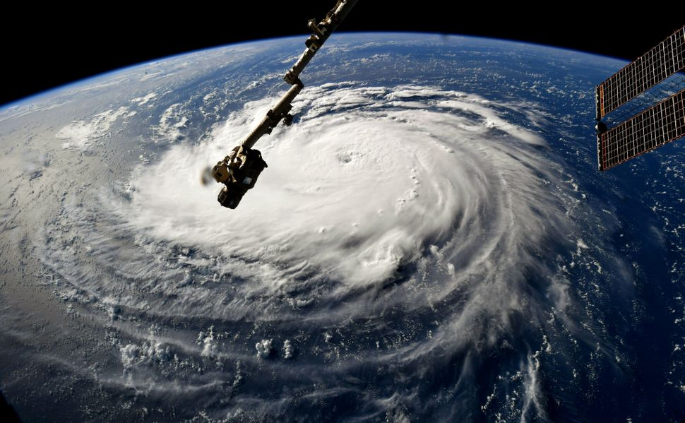 In this NASA handout image taken by Astronaut Ricky Arnold, Hurricane Florence gains strength in the Atlantic Ocean as it mov