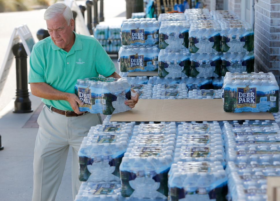 Larry Pierson purchases bottled water from the Harris Teeter grocery store in preparation for Hurricane Florence in Isle of P