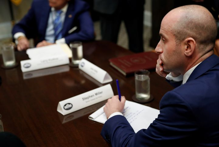 White House policy advisor Stephen Miller takes notes as U.S. President Donald Trump holds a meeting with Republican House an