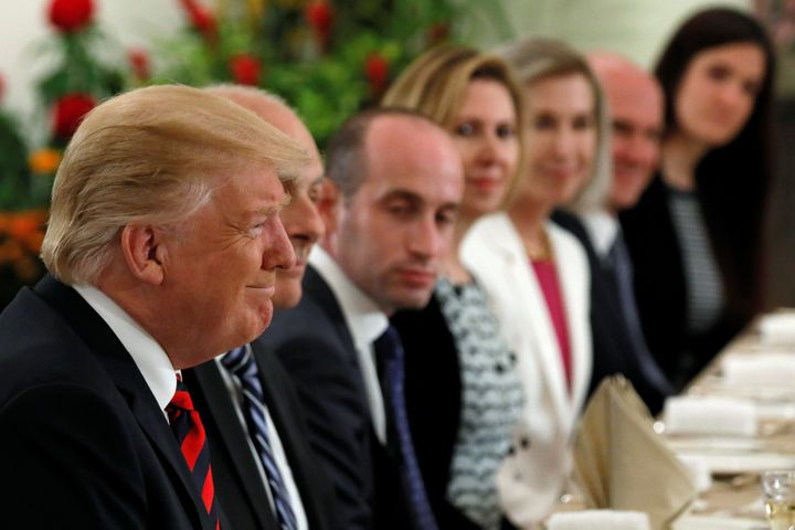 U.S. President Donald Trump and members of his delegation, including White House Senior Advisor Stephen Miller, attend lunch