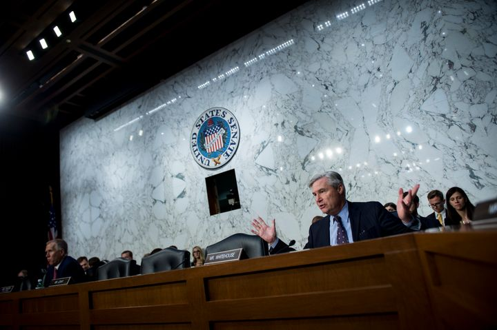 Sen. Sheldon Whitehouse (D-R.I.) questions Supreme Court nominee Brett Kavanaugh as he testifies during a hearing in front of