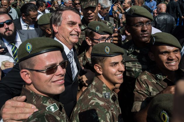 Bolsonaro is seen surrounded by troops at the Sao Paulo