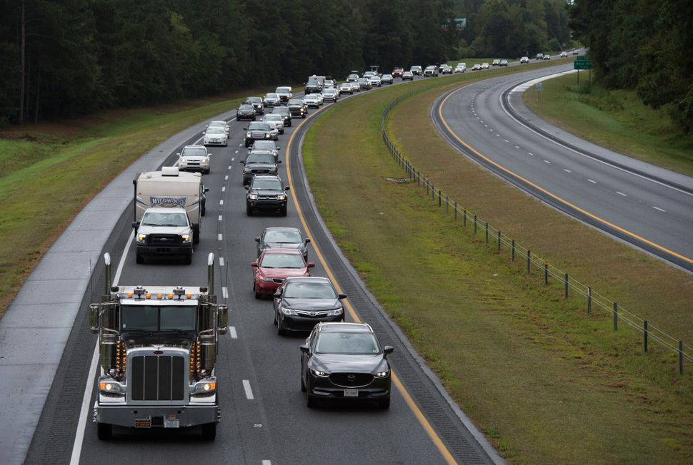 Residents evacuate from coastal areas near Wallace, North Carolina, on Tuesday.