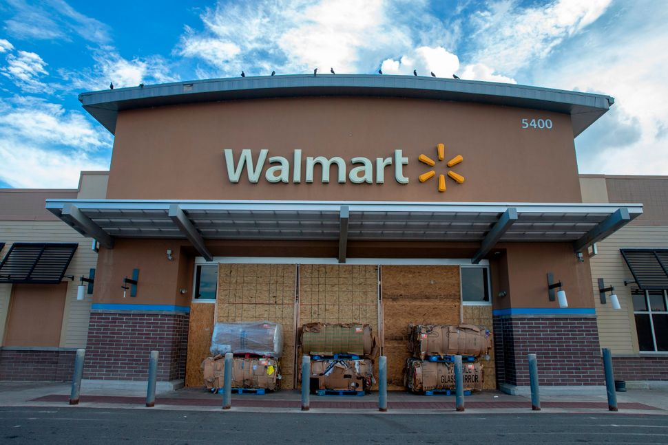 Wood boards and cardboard boxes block the entrance to a Walmart store in Kill Devil Hills in the Outer Banks of North Carolin