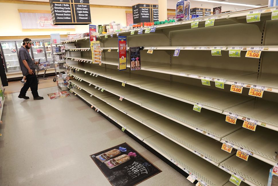 A store's bread shelves are bare as people stock up on food ahead of the arrival of Hurricane Florence on on Tuesday in Myrtl