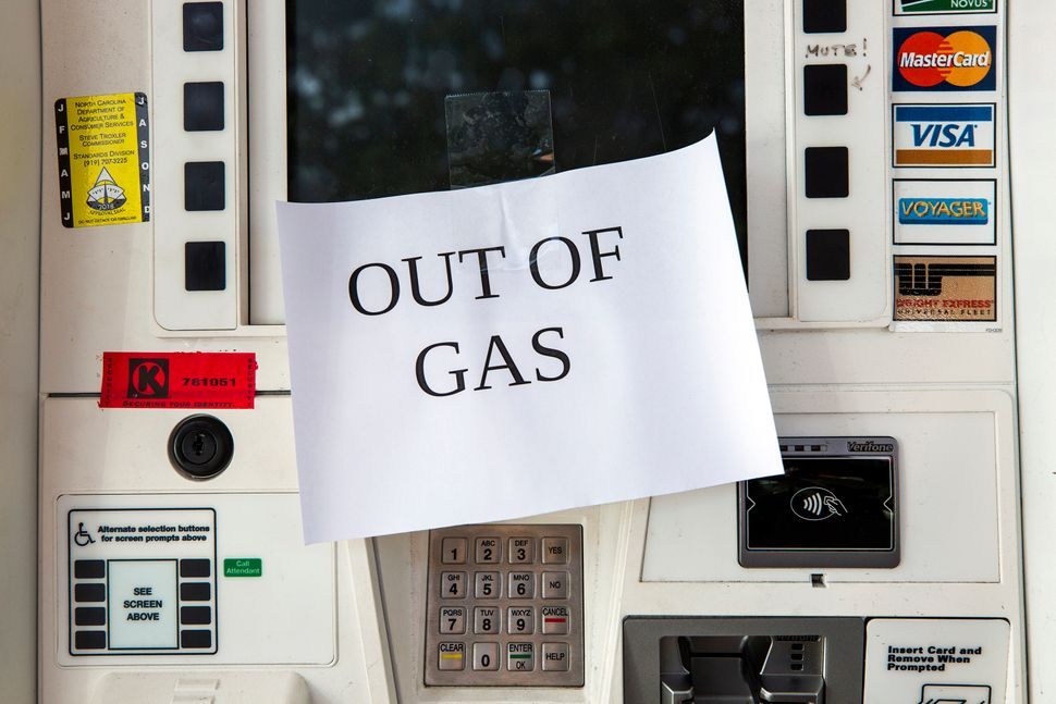 The pumps at the Shell gas station on Western Boulevard featured 'out of gas' signs as people prepared to ride out Hurricane
