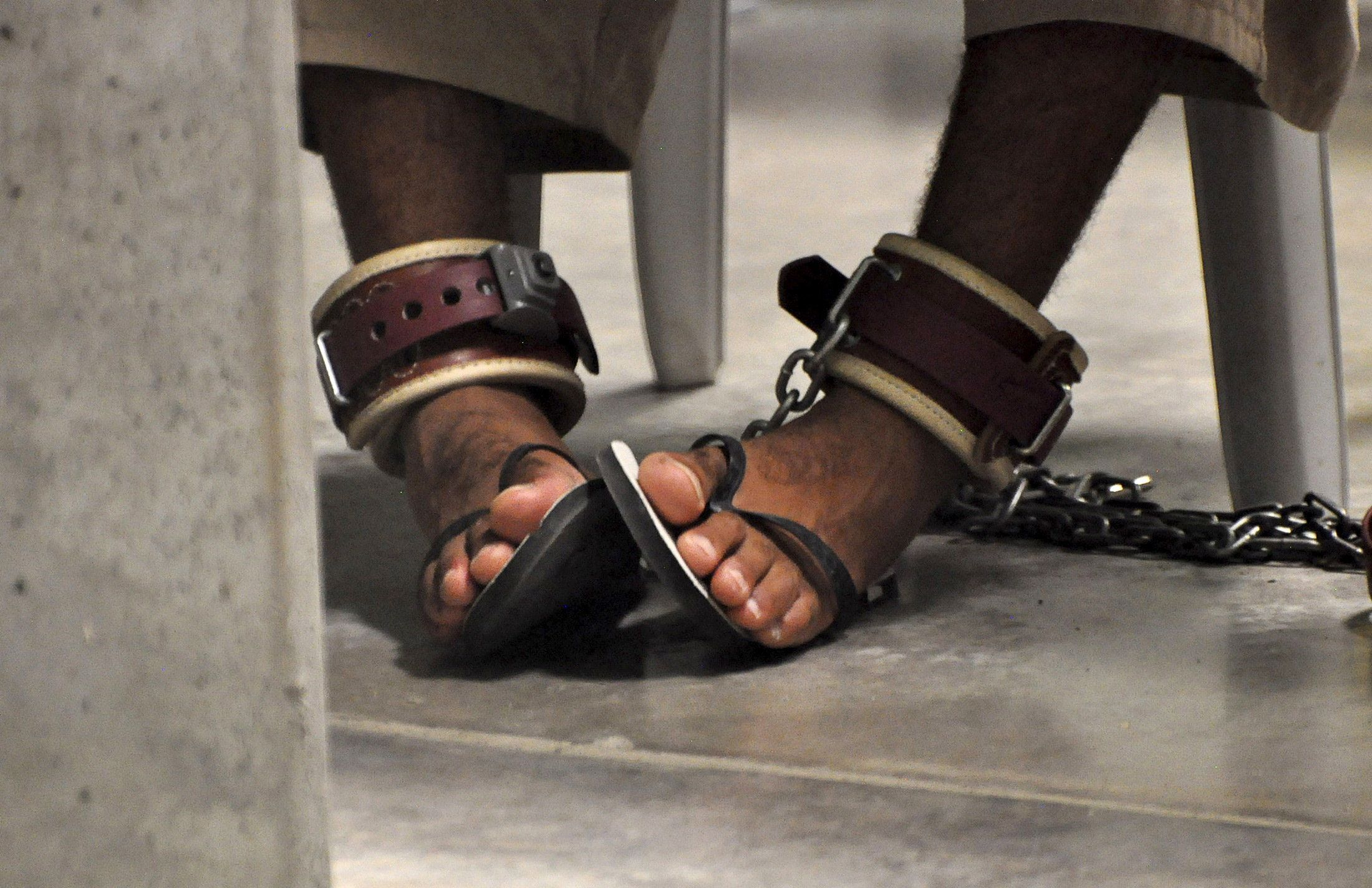 """A Guantanamo detainee's feet are shackled to the floor as he attends a """"Life Skills"""" class inside Guantanamo Bay."""