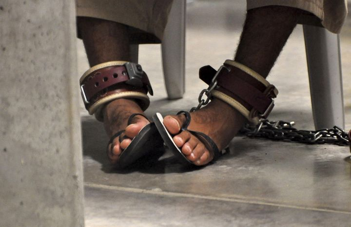 "A Guantanamo detainee's feet are shackled to the floor as he attends a ""Life Skills"" class inside Guantanamo Bay."
