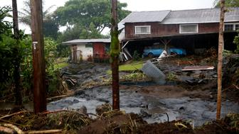 Mud and debris litter a backyard as a result of flooding caused by Hurricane Lane in Hilo, Hawaii, U.S., August 25, 2018.  REUTERS/Terray Sylvester