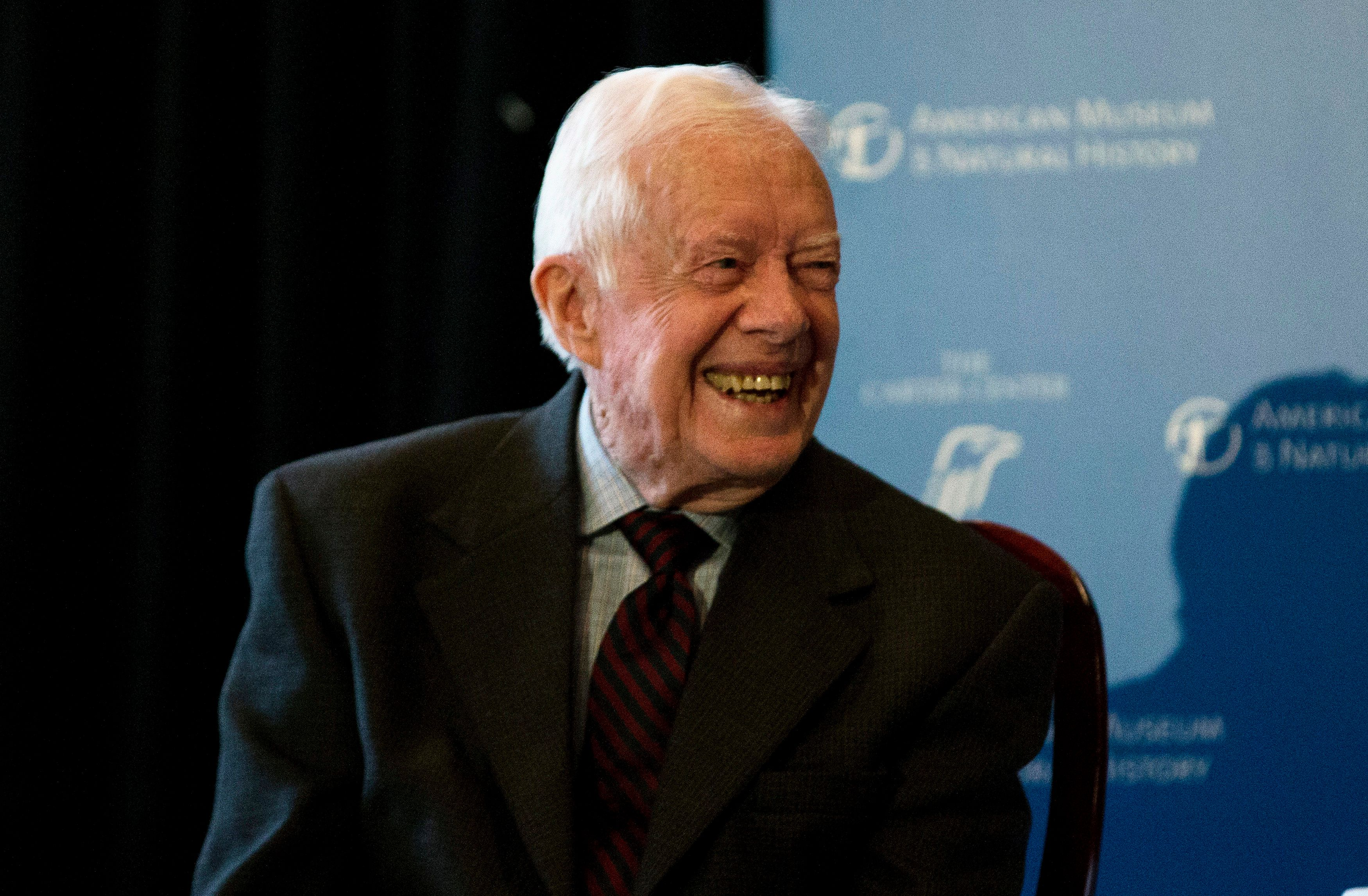"Former U.S. president Jimmy Carter speaks at the opening of a new exhibit, ""Countdown to Zero, Defeating Disease"" at the American Museum of Natural History in New York, January 12, 2015. Developed in collaboration with The Carter Center, the exhibit, which opens on January 13, uses photography, videography, and artifacts to highlight global efforts to fight infections. REUTERS/Mike Segar   (UNITED STATES - Tags: HEALTH POLITICS SOCIETY)"