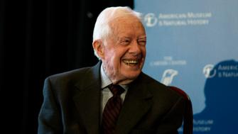 """Former U.S. president Jimmy Carter speaks at the opening of a new exhibit, """"Countdown to Zero, Defeating Disease"""" at the American Museum of Natural History in New York, January 12, 2015. Developed in collaboration with The Carter Center, the exhibit, which opens on January 13, uses photography, videography, and artifacts to highlight global efforts to fight infections. REUTERS/Mike Segar   (UNITED STATES - Tags: HEALTH POLITICS SOCIETY)"""