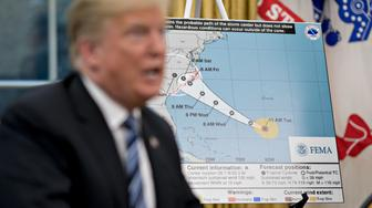 A map of the probable path of Hurricane Florence stands past U.S. President Donald Trump speaking during a meeting with the secretary of the Department of Homeland Security (DHS) and the administrator of the Federal Emergency Management Agency (FEMA) in the Oval Office of the White House in Washington, D.C., U.S., on Tuesday, Sept. 11, 2018. Trump said he expects Hurricane Florence to be among the worst storms to ever strike the U.S., but that the federal government was prepared to respond to the disaster. Photographer: Andrew Harrer/Bloomberg via Getty Images