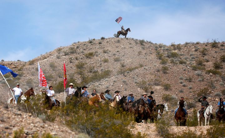 Protesters on horseback ride on the hills above a rally site in Bunkerville, Nevada, April 12, 2014.