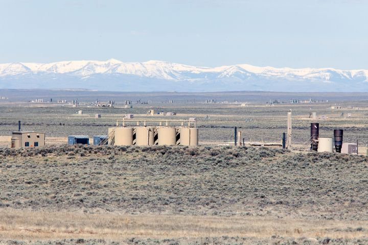 Gas wells and facilities are spread out across the landscape at Jonah Energy field, on May 4, 2018 outside Pinedale, Wyoming.