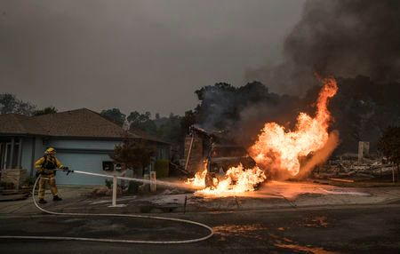 SANTA ROSA, CA - OCTOBER 9:  A Fountaingrove Village homeowner surveys his destroyed home he has owned for 4 years in Santa Rosa on October 9, 2017 in Santa Rosa, California. (Photo by Brian van der Brug/Los Angeles Times via Getty Images)