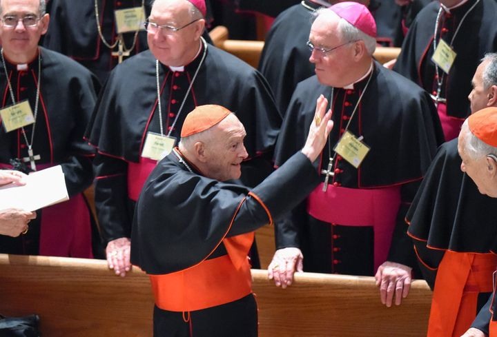Former Cardinal Theodore McCarrick waves to fellow bishops as attends the midday prayer service at the Cathedral of St. Matth