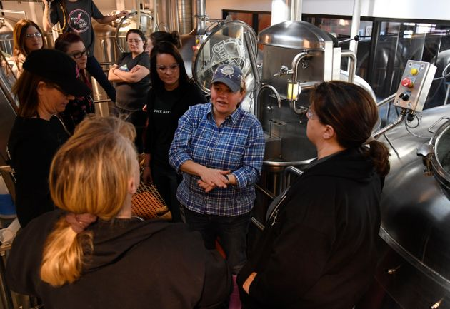 Blue Moon Brewing Co. brewer, Emilie Stewart, center, talks with women brewers during a Pink Boots Society...