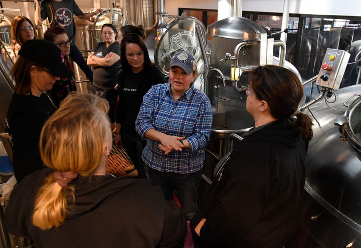 Blue Moon Brewing Co. brewer, Emilie Stewart, center, talks with women brewers during a Pink Boots Society event at Blue Moon