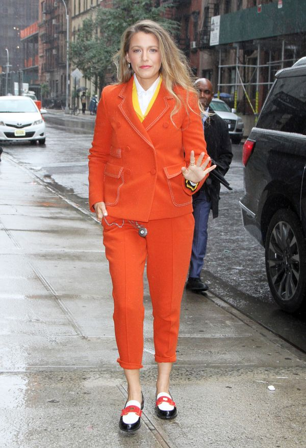 Lively then stepped out in this bright orange suit by Bottega Veneta when she made an appearance at Twitter.