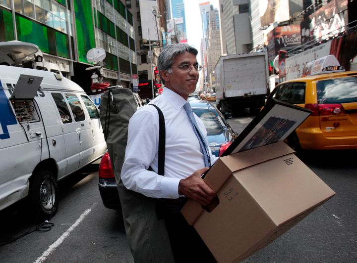 An employee of Lehman Brothers Holdings Inc. carries a box out of the company's headquarters building on Sept. 15, 2008, in N