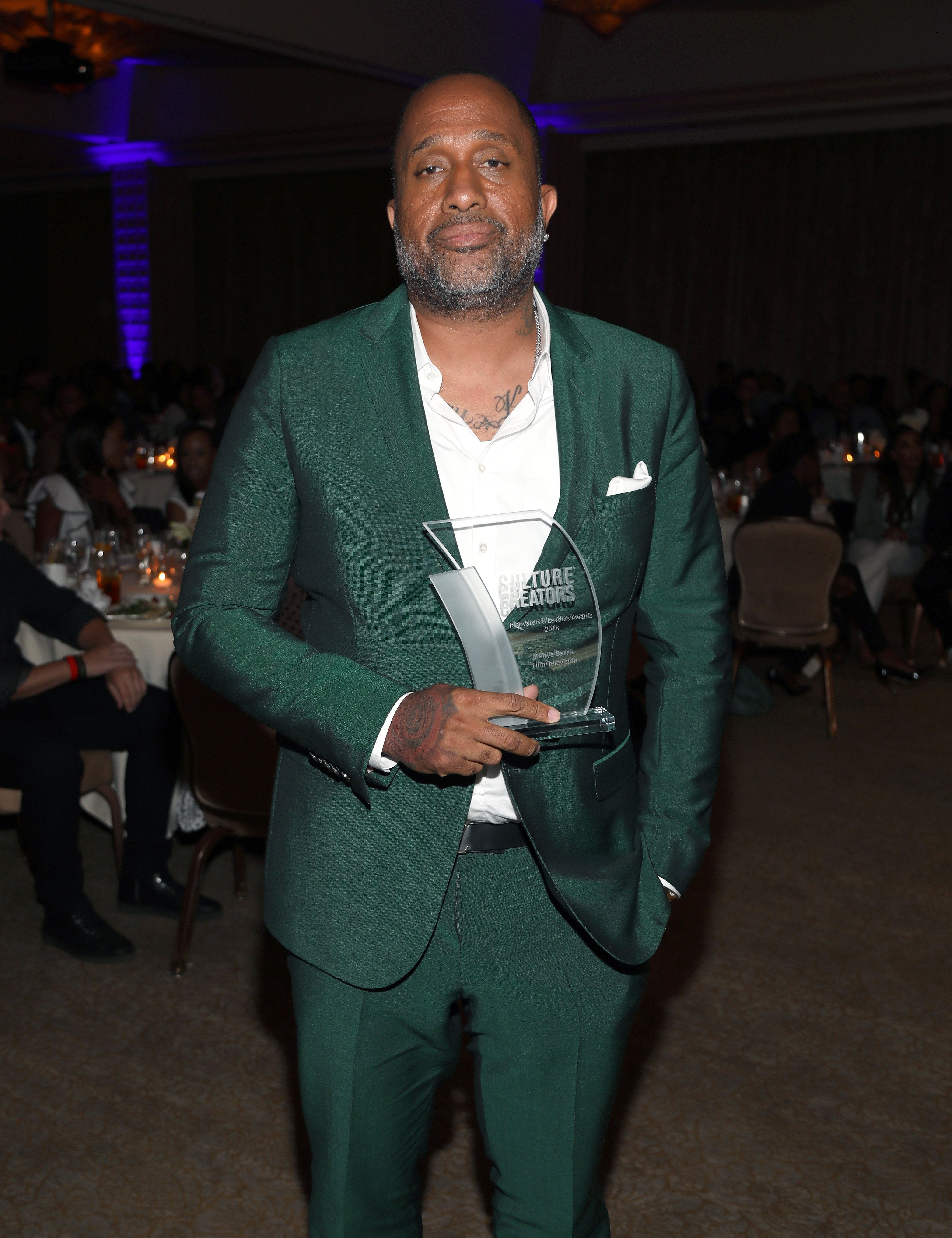 BEVERLY HILLS, CA - JUNE 22:  Kenya Barris poses with his award during Culture Creators Leaders and Innovators Awards Brunch 2018 at The Beverly Hilton on June 22, 2018 in Beverly Hills, California.  (Photo by Jerritt Clark/Getty Images for Culture Creators )