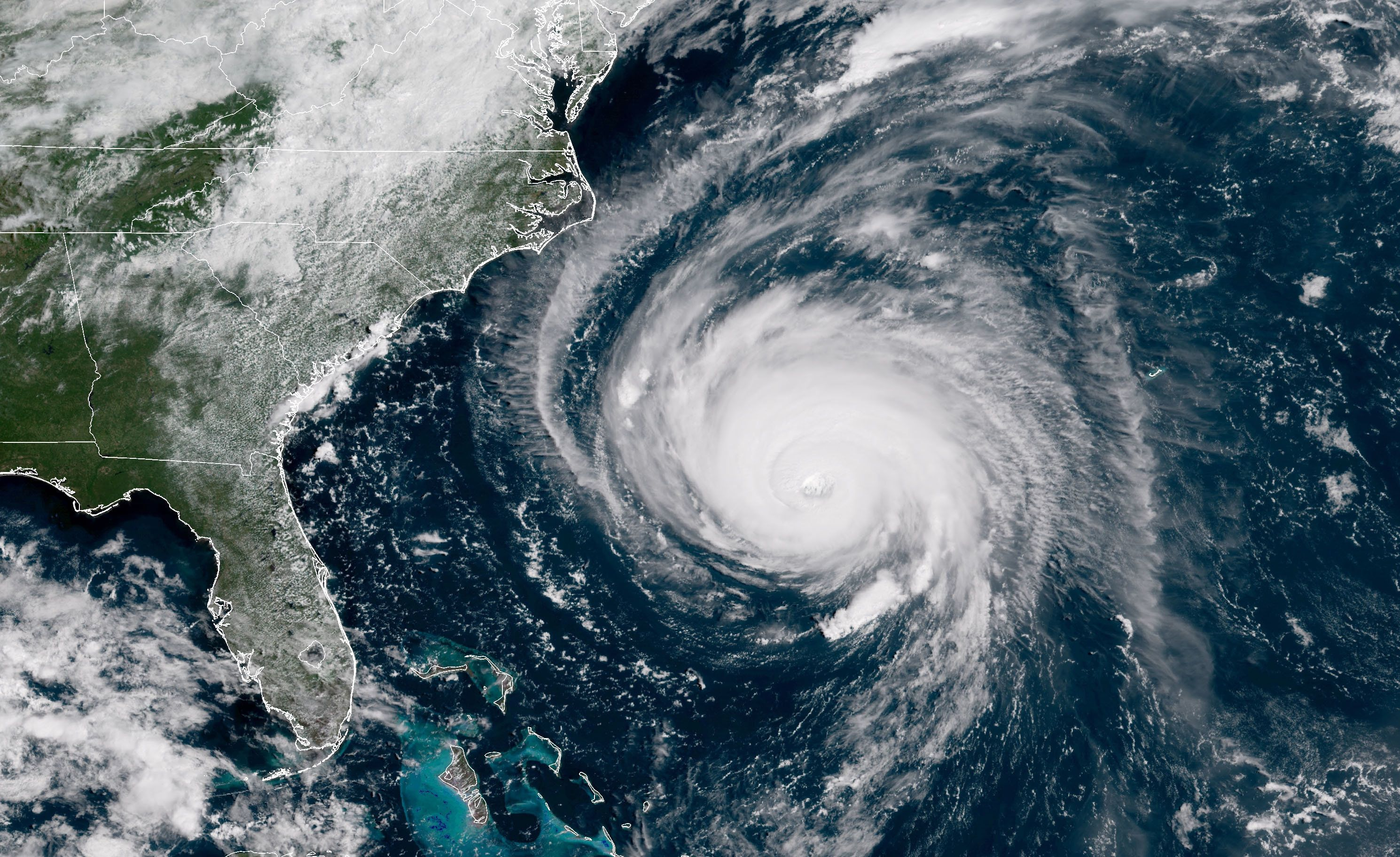 IN SPACE - SEPTEMBER 12:  In this satellite image provided by U.S. National Oceanic and Atmospheric Administration (NOAA), Hurricane Florence churns through the Atlantic Ocean toward the U.S. East Coast on September 12, 2018. Florence slowed its approach to the U.S. today and was forecast to turn south, stalling along the  North Carolina and South Carolina coast and bringing with it torrential rain, high winds and a dangerous storm surge tomorrow through Saturday.  (Photo by NOAA via Getty Images)